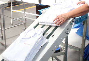Lab coats being folded